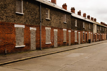 Bricked Up And Abandoned Town Houses In A Run-down City Street In Belfast