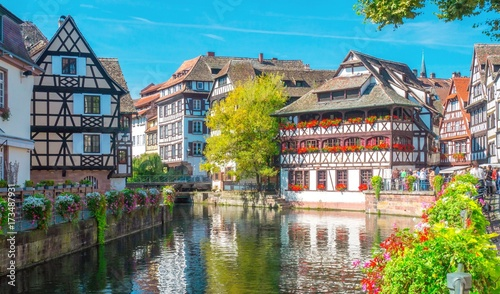 Photo  Typical house near water and flowers from La Petite France in Strasbourg, Alsace