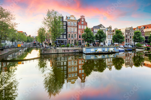 Photo  Amsterdam Canal houses at sunset reflections, Netherlands