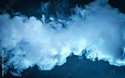 Fotografía  Cloud of vapor. dark blue background