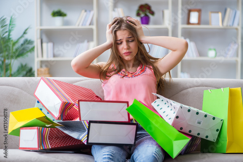 Fototapeta Young woman with shopping bags indoors home on sofa obraz