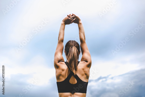 Fototapeta Young woman stretching