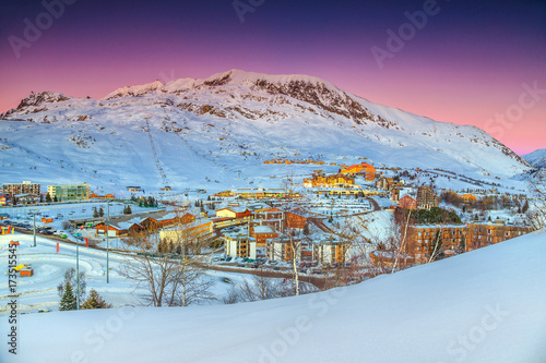 Fotobehang Aubergine Wonderful sunset landscape with winter ski resort in France, Europe