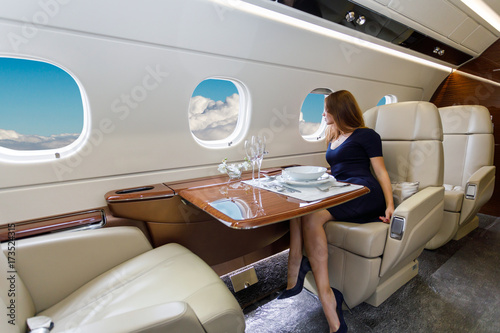 young beautiful woman in Luxury interior in the business jet Fototapeta