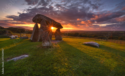 Leinwand Poster Sunset over the old Dolmen