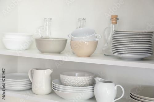 Kitchen cupboard with different clean dinnerware