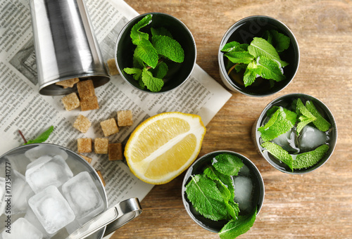 Valokuva  Composition with mint julep, lemon and sugar on kitchen table