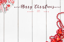 Christmas And New Year Background With Thuja Branch, Decorations And Presents Wrapped In Craft Paper With Snowflakes. Flat Lay, Top View.