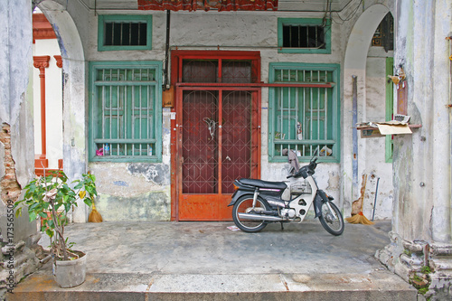 Wall Murals Pizzeria Quintessential Malaysia doorway scene with motorbike, typical across SE Asia, as seen in Penang