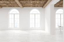 Empty Room With Large Rounded Windows
