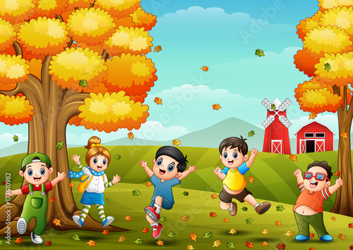 Spoed Foto op Canvas Turkoois Happy children playing in farm landscape at autumn