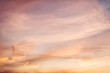 Dramatic cloudy pastel colored sunset sky