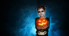 Magic Skeleton With  Pumpkin. Baby Girl In Costume To Halloween.