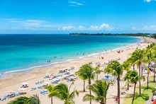 Puerto Rico Beach Travel Vacation Landscape Background. Isla Verde Resort In San Juan, Famous Tourist Cruise Ship Destination In The Caribbean.