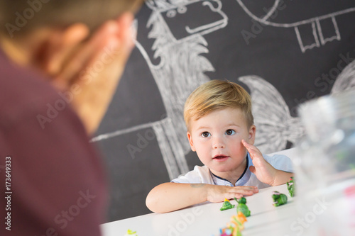 Cute little playfull toddler boy at child therapy session Canvas-taulu