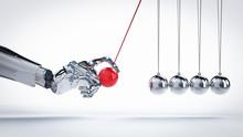 Robot Hand Holding Newton Cradle