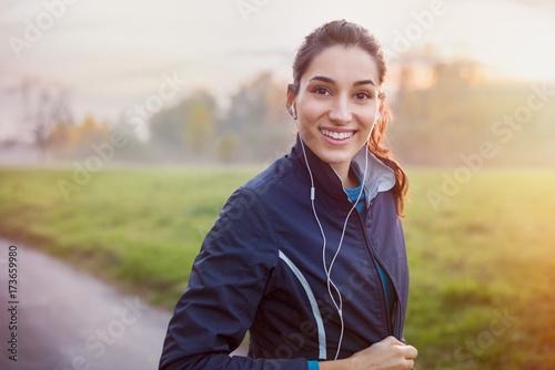 Foto  Runner listening music