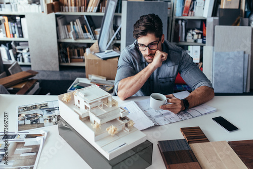 Young male architect taking break from work Canvas Print