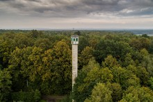 Tall Watch Tower In The Forest.