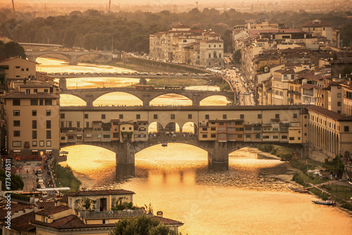 Foto op Canvas Florence Aerial view of Florence at sunset with the Ponte Vecchio and the Arno river, Tuscany, Italy