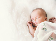 Sleeping Newborn Baby In A Wra...