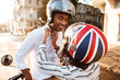 Young african couple in moto helmets