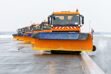 Snowplows In The Work On The R...