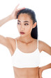 Half-body isolated portrait of sexy Asian woman in white top