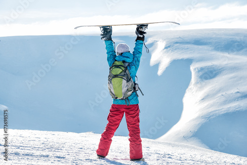 snowboarder-girl-standing-with-snowboard