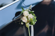 canvas print picture - Luxury black wedding car decorated with flowers.