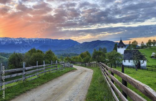 Obraz Traditional easy mountain Monastery and stunning sunset,Bran,Transylvania,Romania - fototapety do salonu