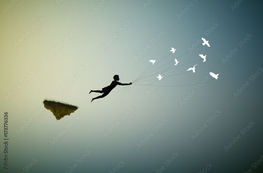 Fototapeta boy is flying away and holding pigeons, fly in the dream land,fly away, shadows,