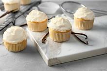 Tasty Vanilla Cupcakes On Marb...