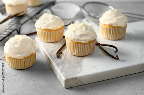Tasty vanilla cupcakes on marble board Wallpaper Mural