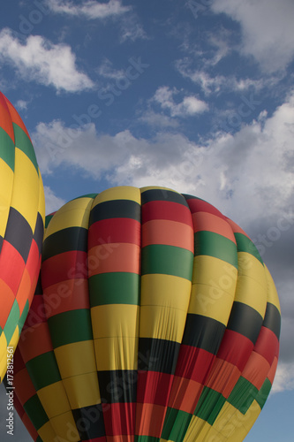 Foto op Canvas Luchtsport Colorful hot air balloon with puffy clouds in background