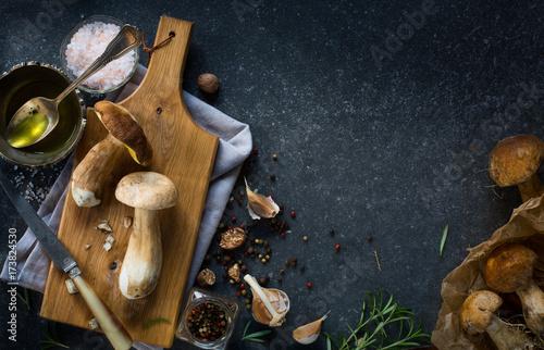 Poster Cuisine autumn cooking background; organic porcini Mushroom; seasoning forest Mushroom and Italian Spices Herb