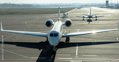 Fototapety, obrazy: Private jet planes on the landing line in the morning time.