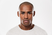 Serious Young African Man Standing Isolated