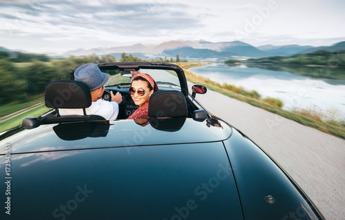 In love couple traveling by cabriolet car - 173943551