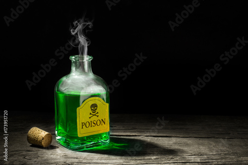 The poison is a green liquid in a glass vial Canvas Print
