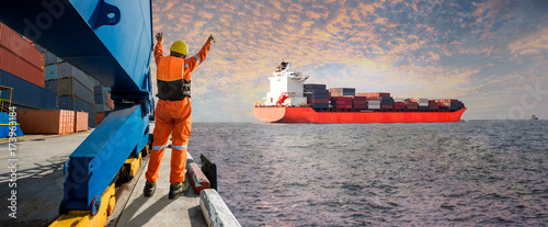 Valokuva  Panorama Container ship vessel departure from the sea port terminal after comple