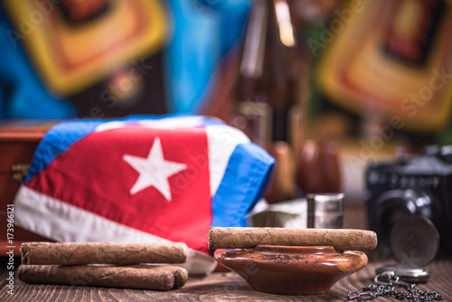 Photo  Items related to Cuba on wooden table