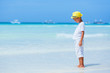 Boy having fun on tropical ocean beach. Kid during family sea vacation.