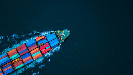 Fototapeta Aerial view from drone, container ship or cargo ship in import export and business logistic.