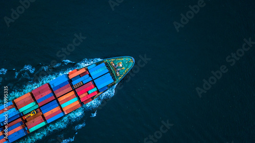 Fotografie, Obraz Aerial view from drone, Container ship or cargo shipping business logistic import and export freight transportation by container ship in open sea, Container loading cargo freight ship boat