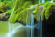 Detail Of Beautiful Waterfall Full Of Green Moss