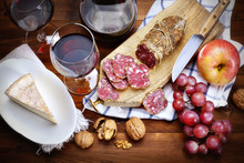 Salami, Cheese, Grapes, Apple, Walnuts And Red Wine