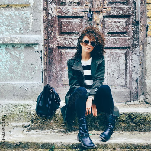 Fashion portrait of curly hair girl outdoor Wall mural