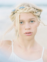 Blonde Girl With Braid And Rib...
