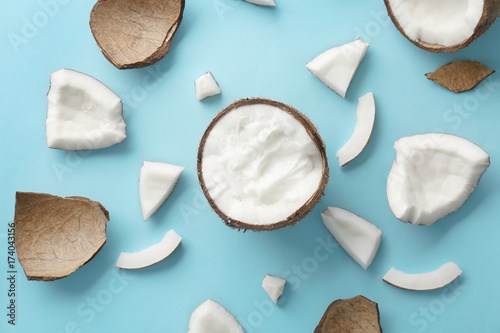 Composition with fresh coconut oil on color background